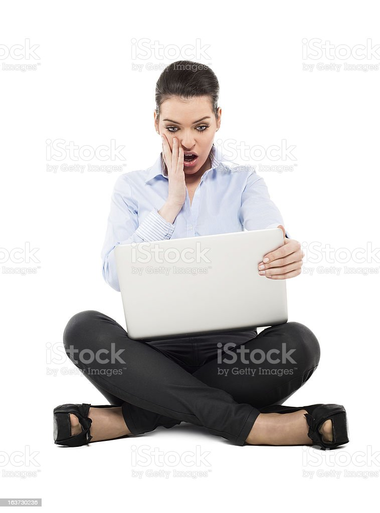 shocked woman sitting with laptop royalty-free stock photo