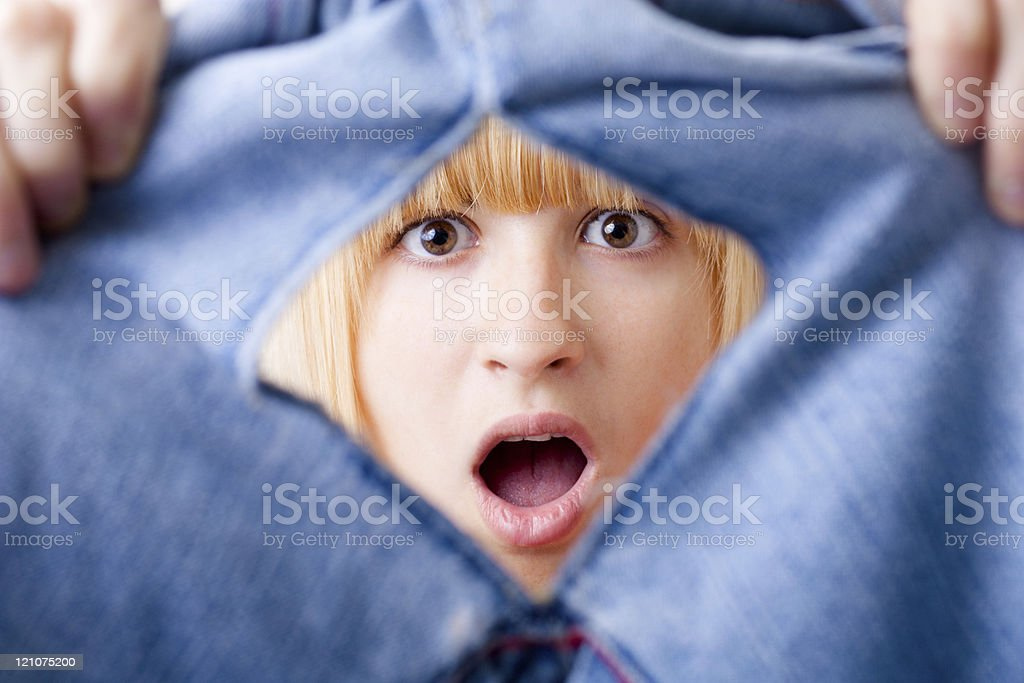 Shocked Woman with Torn Jeans stock photo