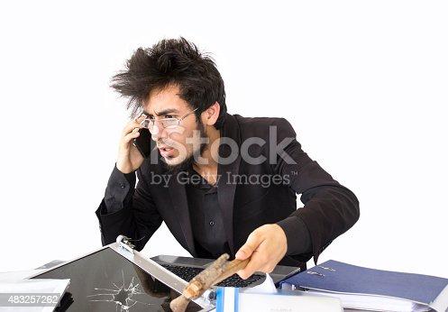 865714662istockphoto Shocked young businessman talking on phone 483257262