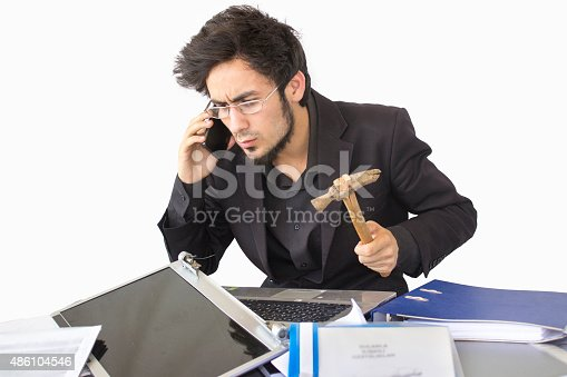 865714662 istock photo Shocked young businessman talking on phone 486104546
