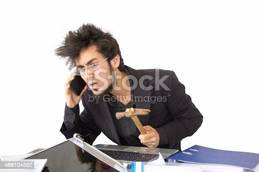 865714662 istock photo Shocked young businessman talking on phone 486104552