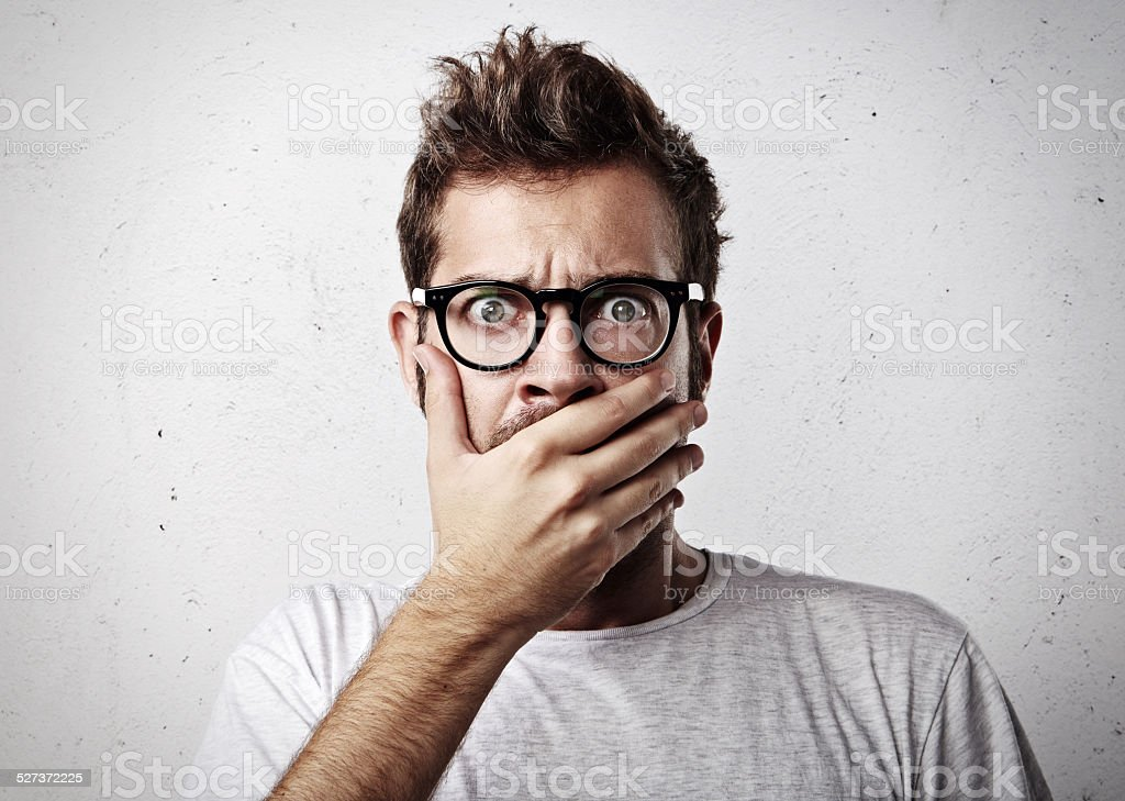 Shocked young man stock photo
