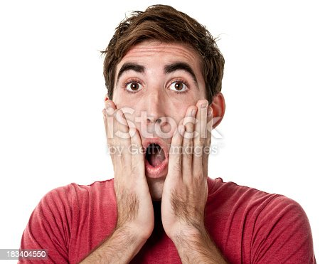 istock Shocked Young Man With Hands On Cheeks 183404550