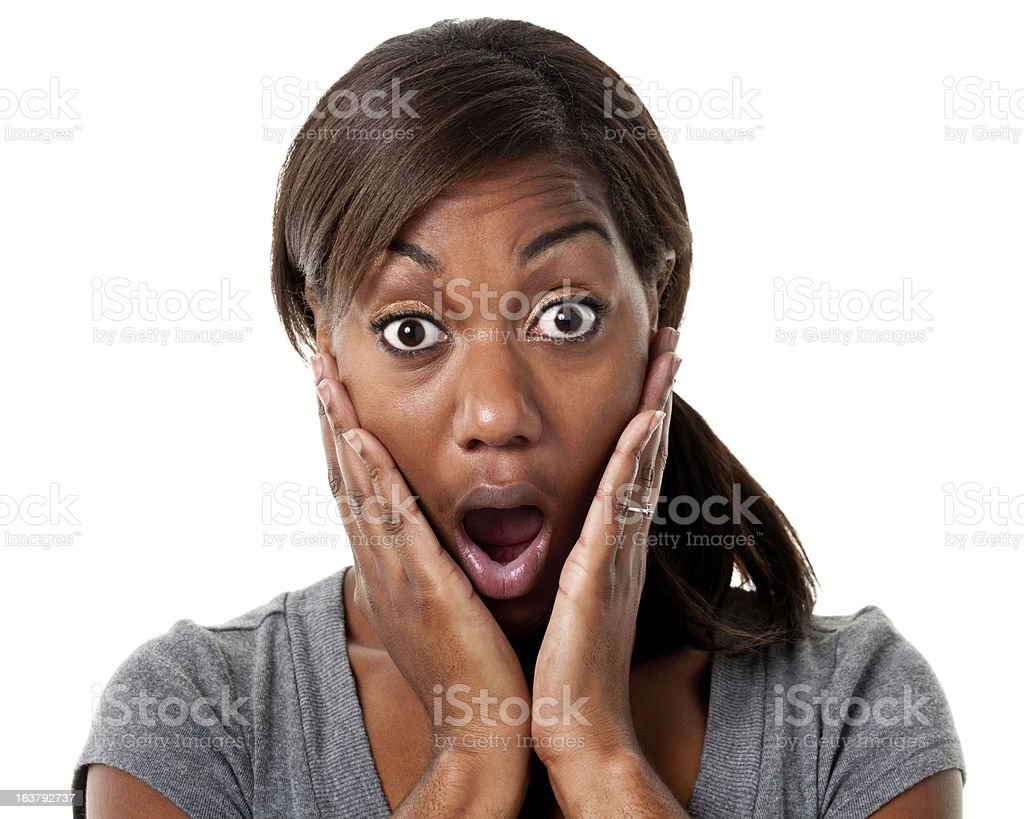 Shocked young woman covers her cheeks with her hands stock photo