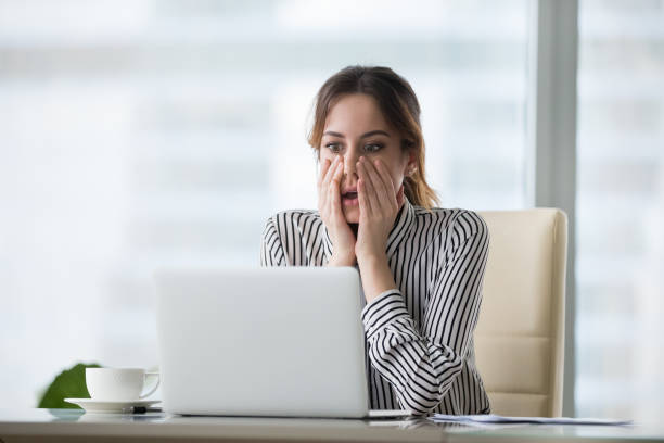 Shocked young woman looking at laptop screen. Shocked young woman looking at laptop screen. Frightened businesswoman receiving bad news, deal broke down, notification, bankruptcy, troubled with financial problems or debt. mistake stock pictures, royalty-free photos & images
