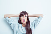 istock Shocked young woman 525347436