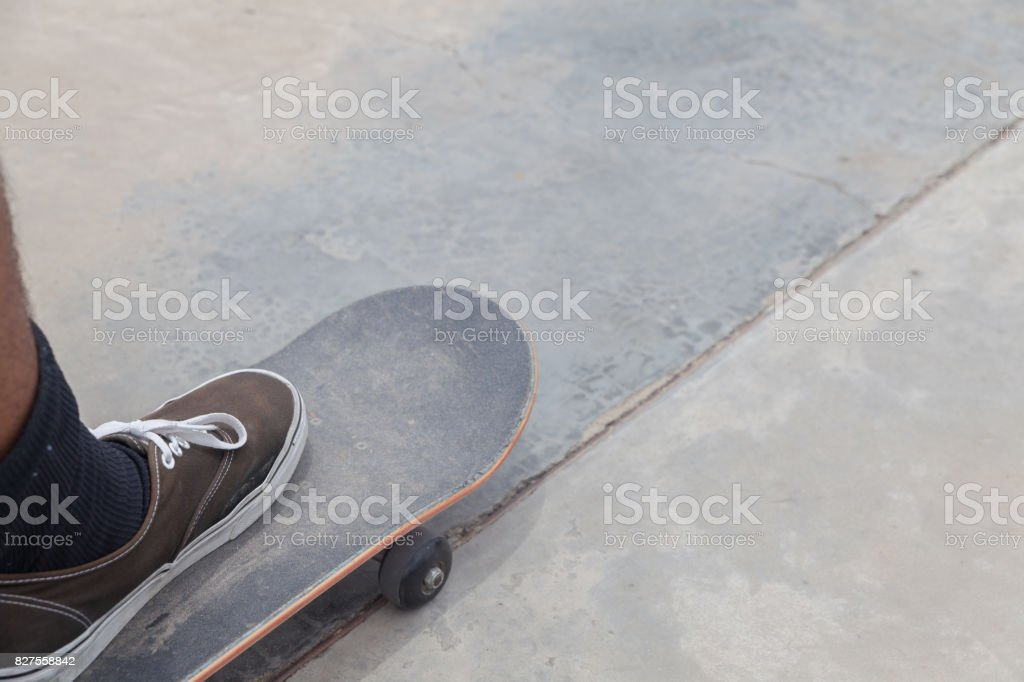 shoe and skateboard on concrete ramp stock photo