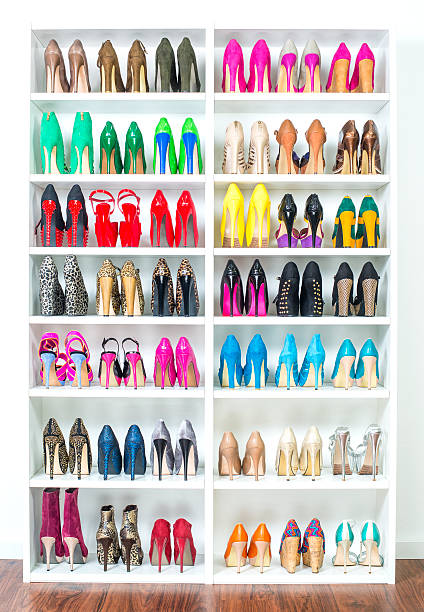 shoe closet with lots of colorful high heels, xxxl image - shoe stock photos and pictures