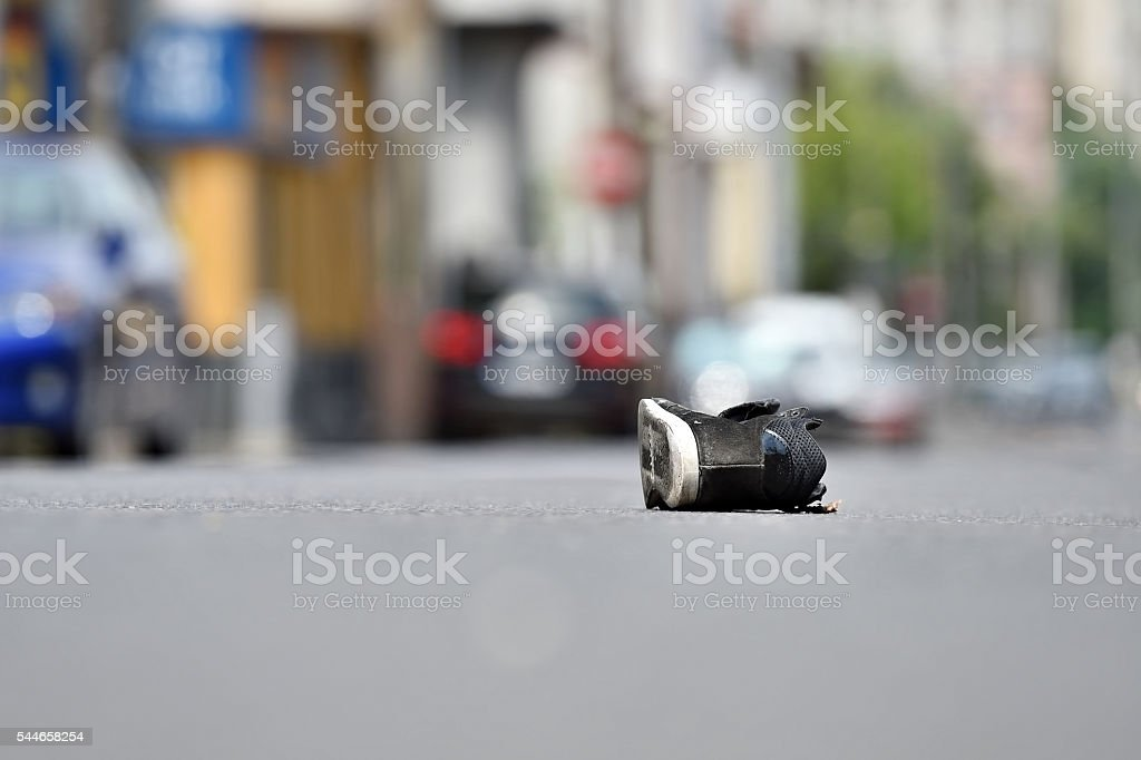 Shoe on the street after accident stock photo