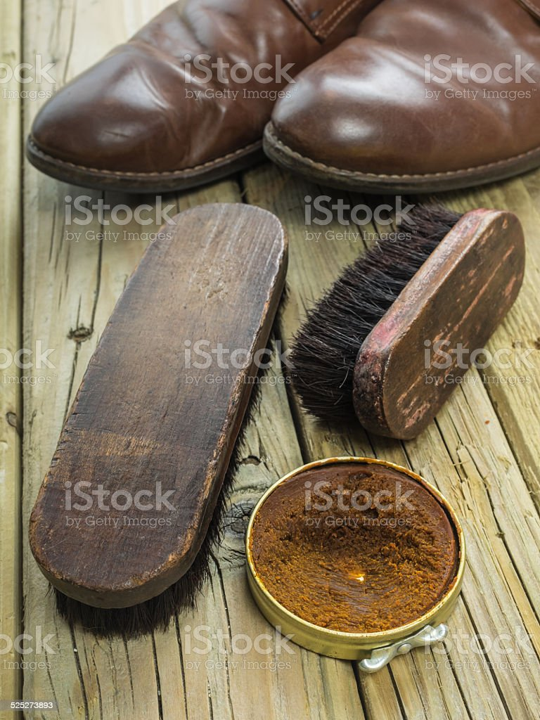 shoe polish and old shoes stock photo