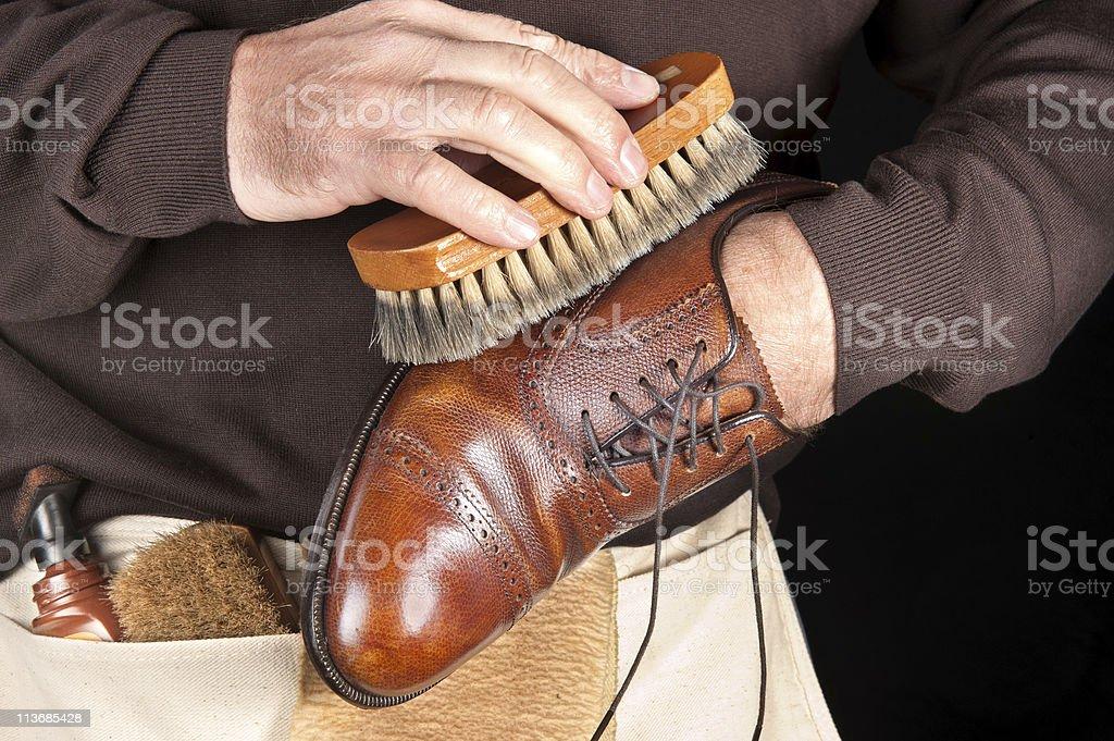 Shoe polisher stock photo