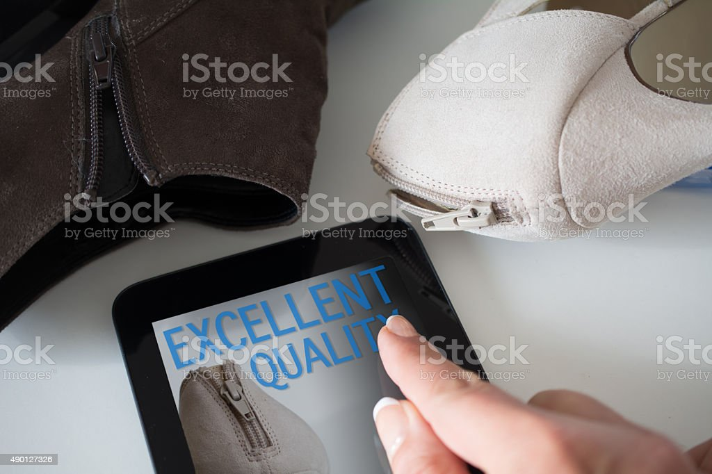 Quality check on a digital tablet finger tabs on Excellent next to...