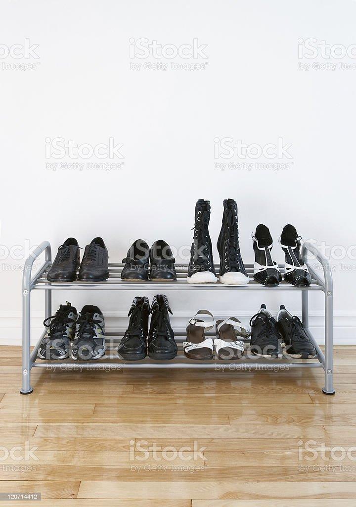 Shoe rack on a wooden floor stock photo