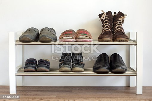 Six pairs of shoes on a shelf in the hallway in the house for the whole family