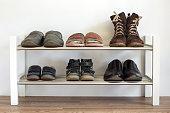 istock Shoe shelf at home 474370206