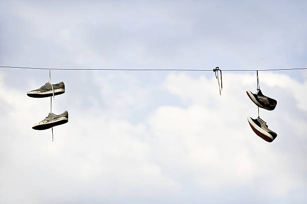 shoe tossing on electric cable - kabelschuhe stock-fotos und bilder