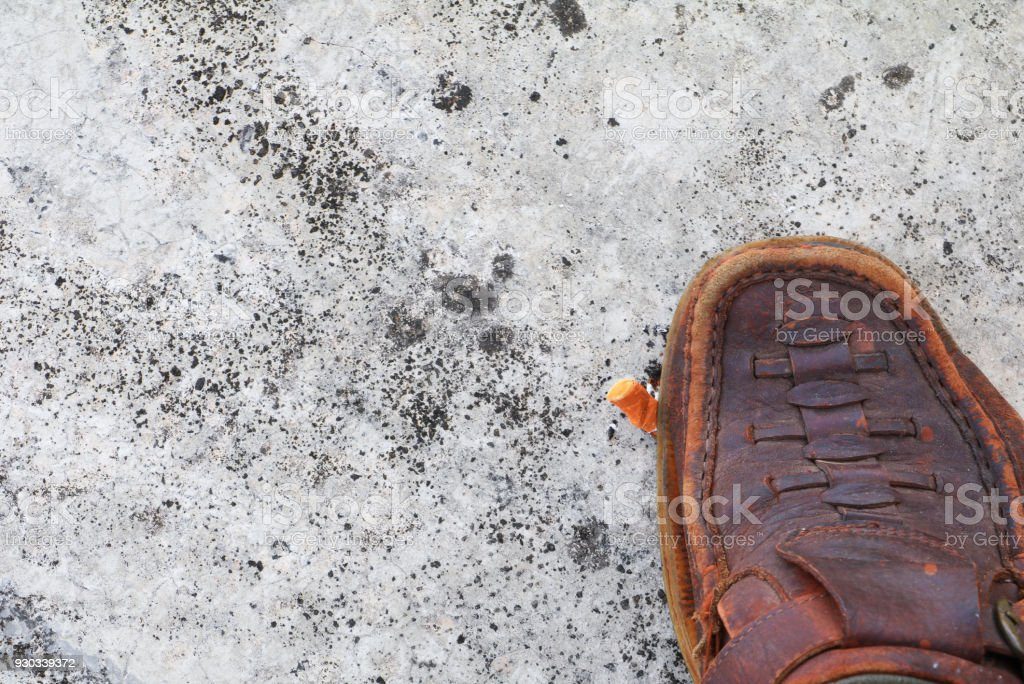 shoe tread cigarette on cement background. concept Non-smoking day universal stock photo