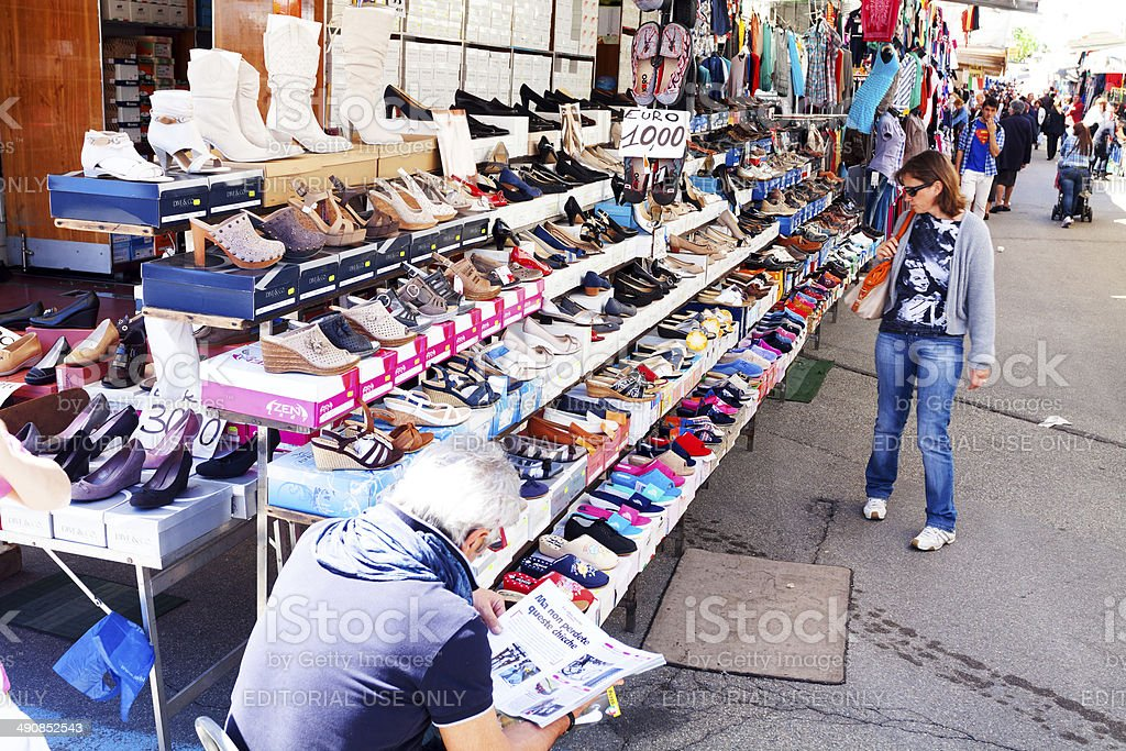 Shoe vendor and market stall royalty-free stock photo