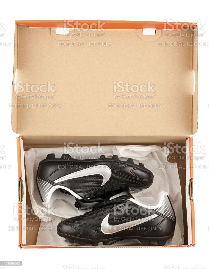 Shoebox containing childrens Nike soccer cleats royalty-free stock photo