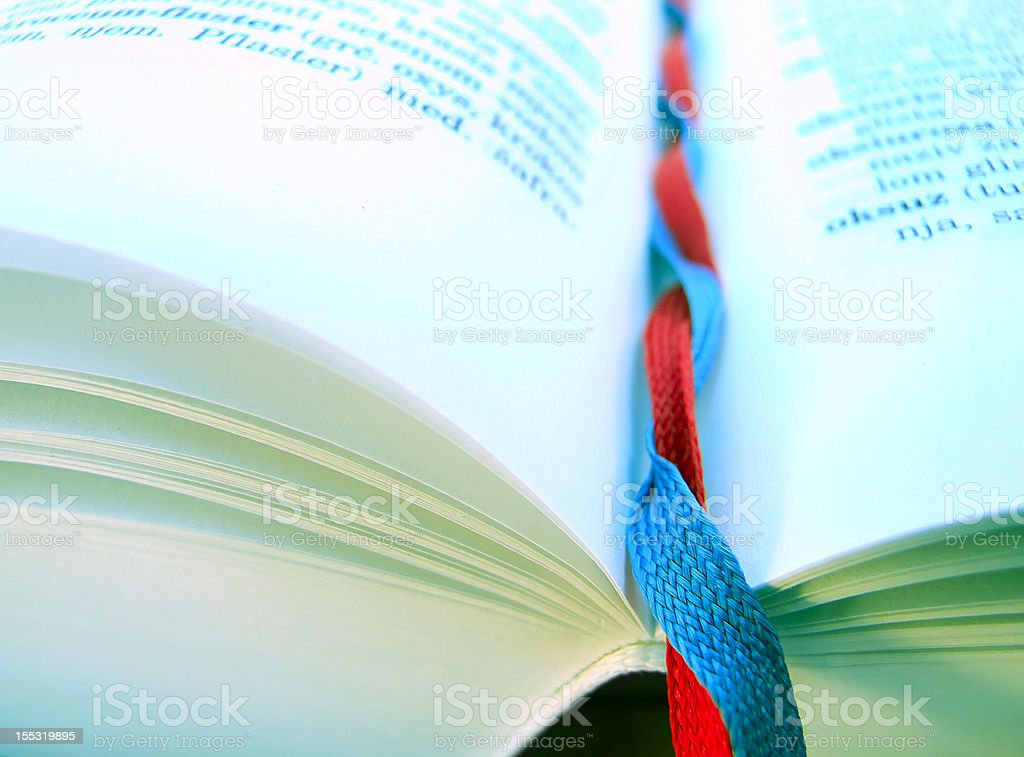 Shoelace bookmarks and book royalty-free stock photo