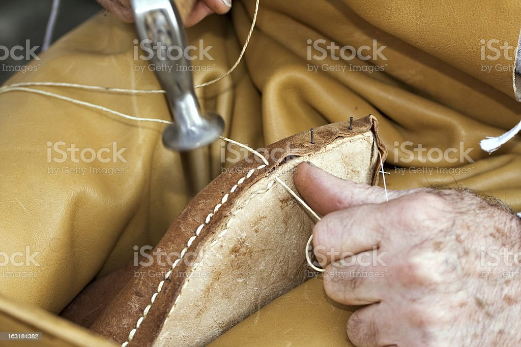 Shoemaker at work stock photo