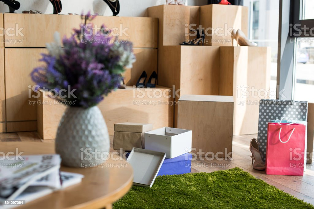 shoes and boxes in boutique royalty-free stock photo