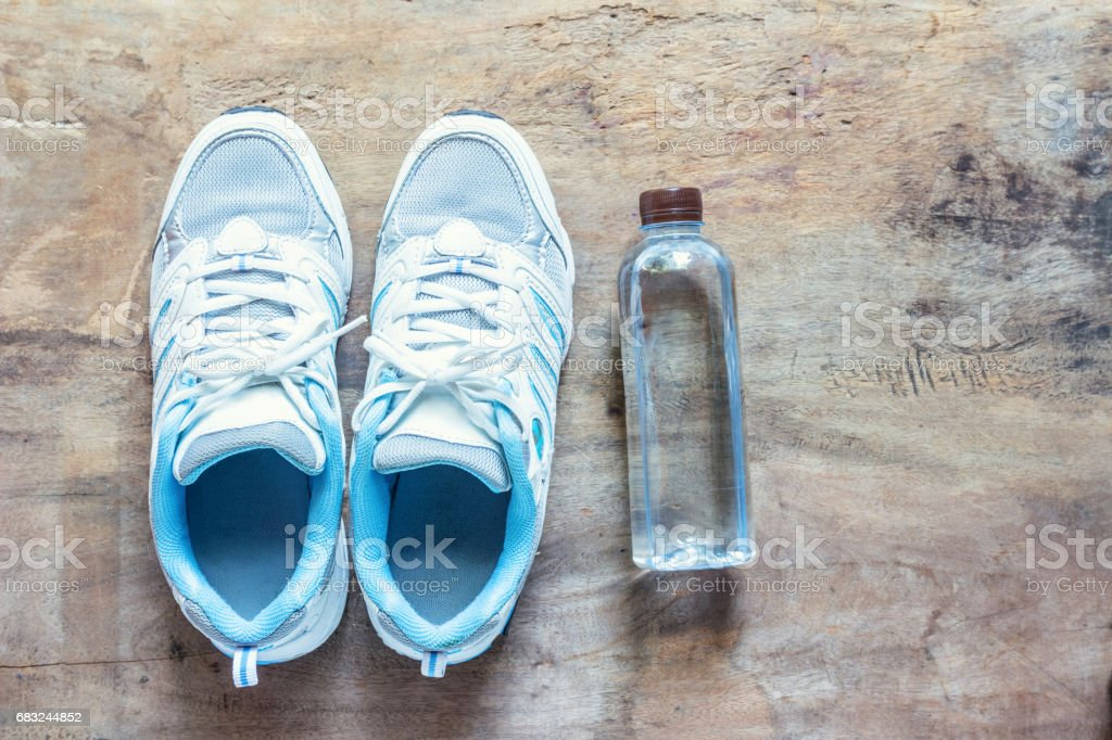 Shoes and Drinking Water on Wood Floors, for Exercise 免版稅 stock photo