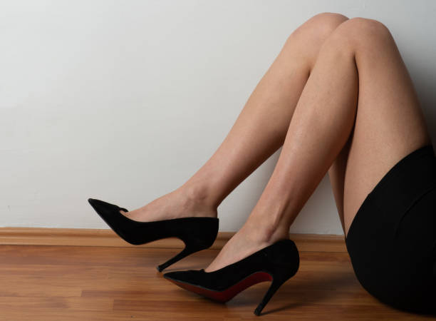 Shoes and legs stock photo