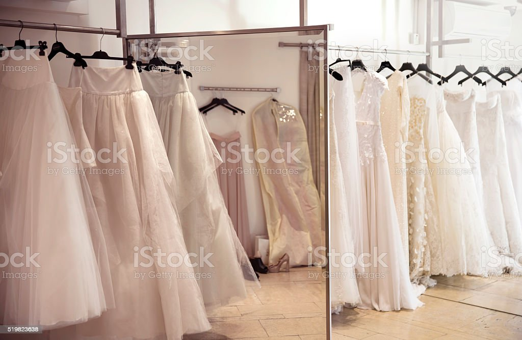 Shoes and wedding dresses stock photo