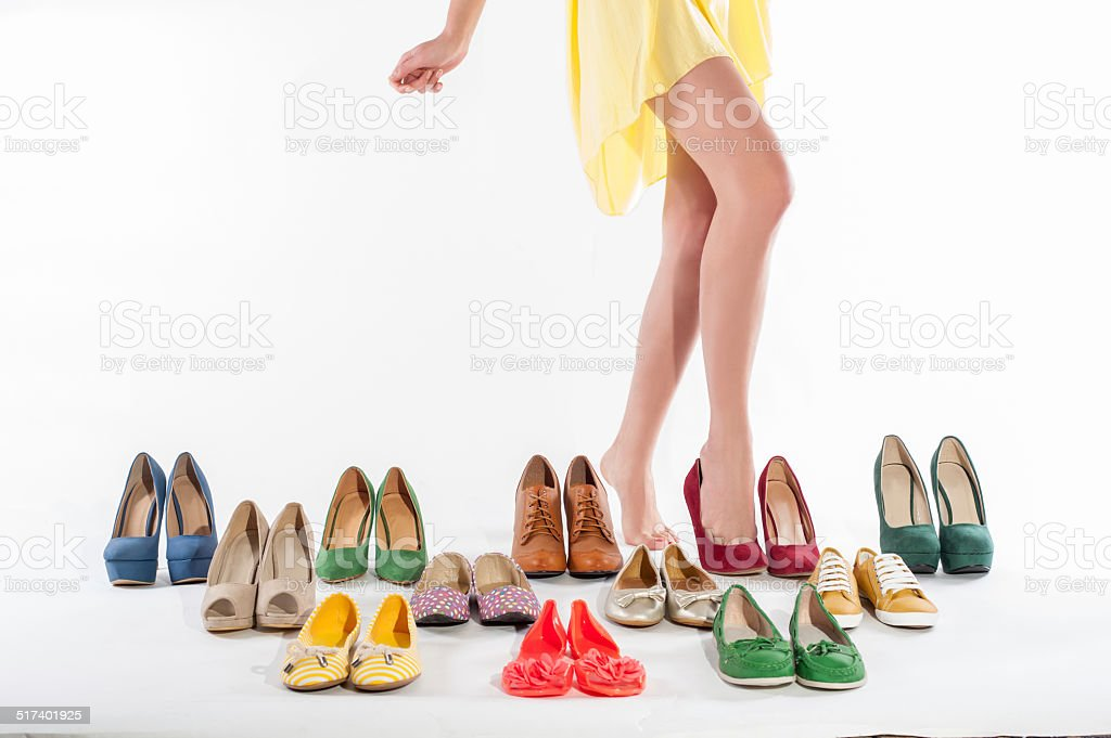 Shoes collection and female legs in fashion shoes stock photo