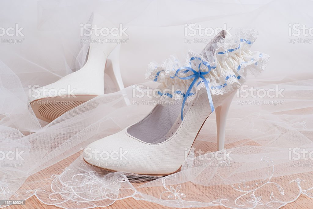 Shoes for the bride and bridal garter. stock photo
