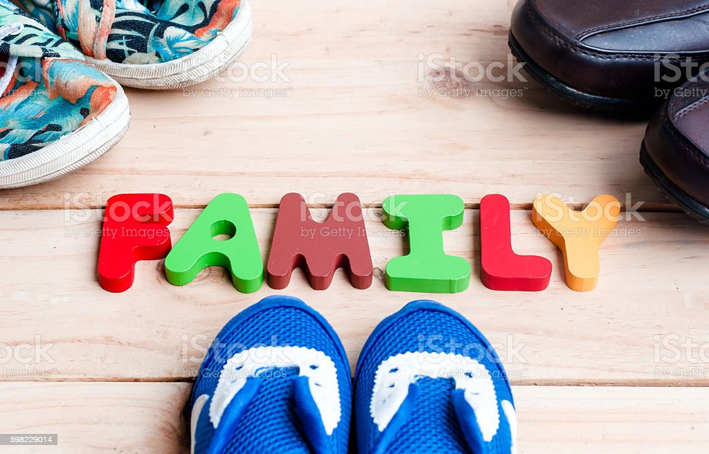 Shoes for the entire family with family alphabet foto royalty-free