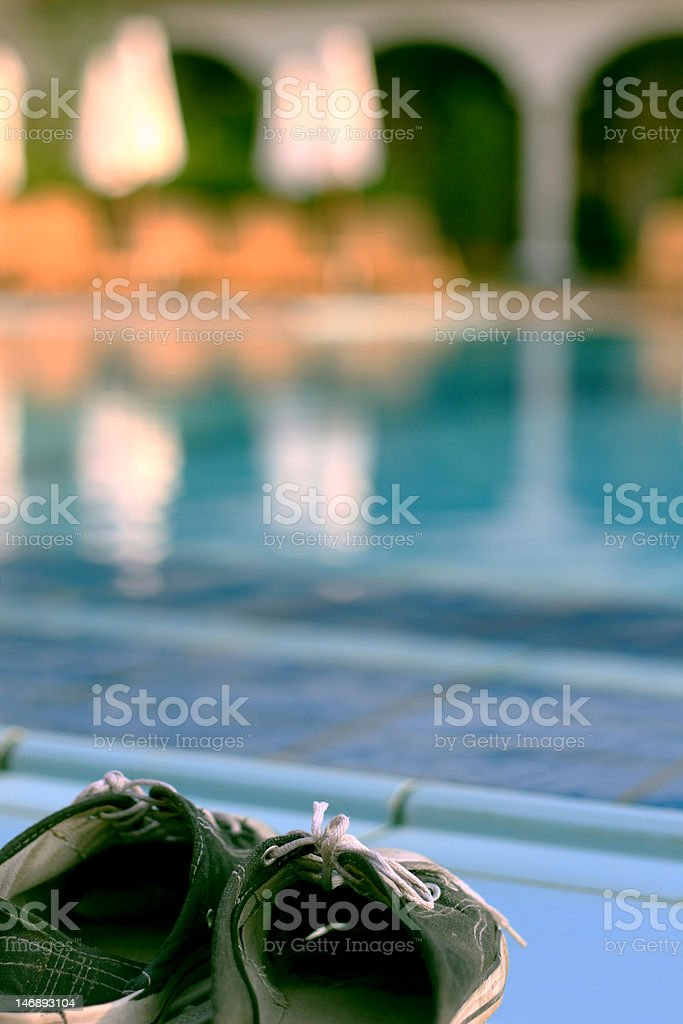 Shoes go swimming royalty-free stock photo