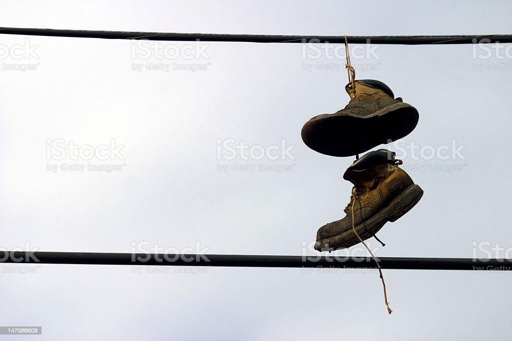 Shoes Hanging from a telephone wire royalty-free stock photo