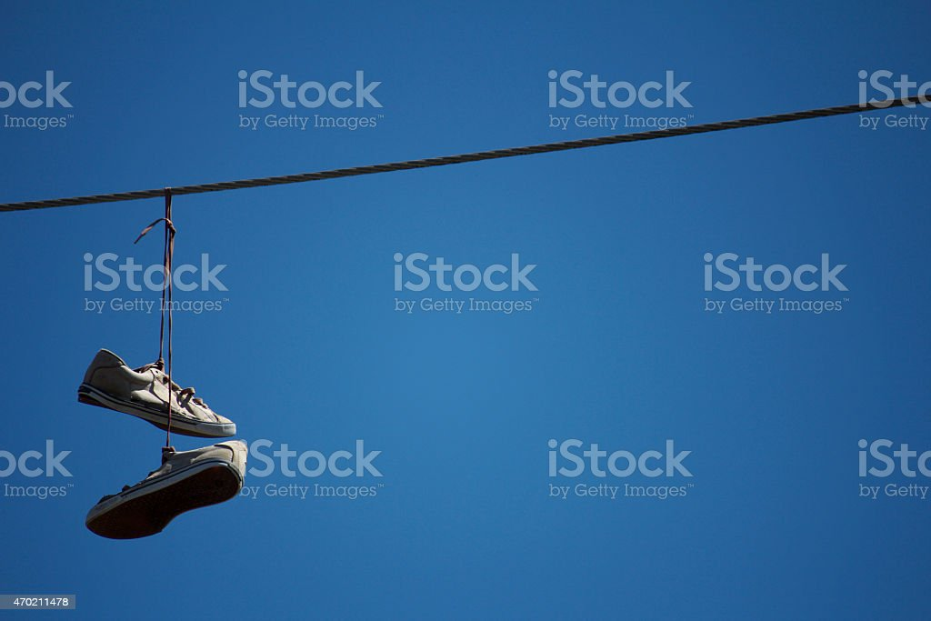 Shoes Hanging on a Telephone Wire stock photo