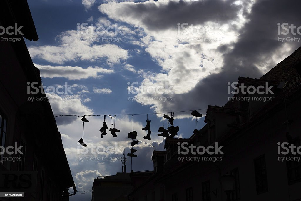 Shoes hanging on power lines, Ljubljana, Slovenia stock photo