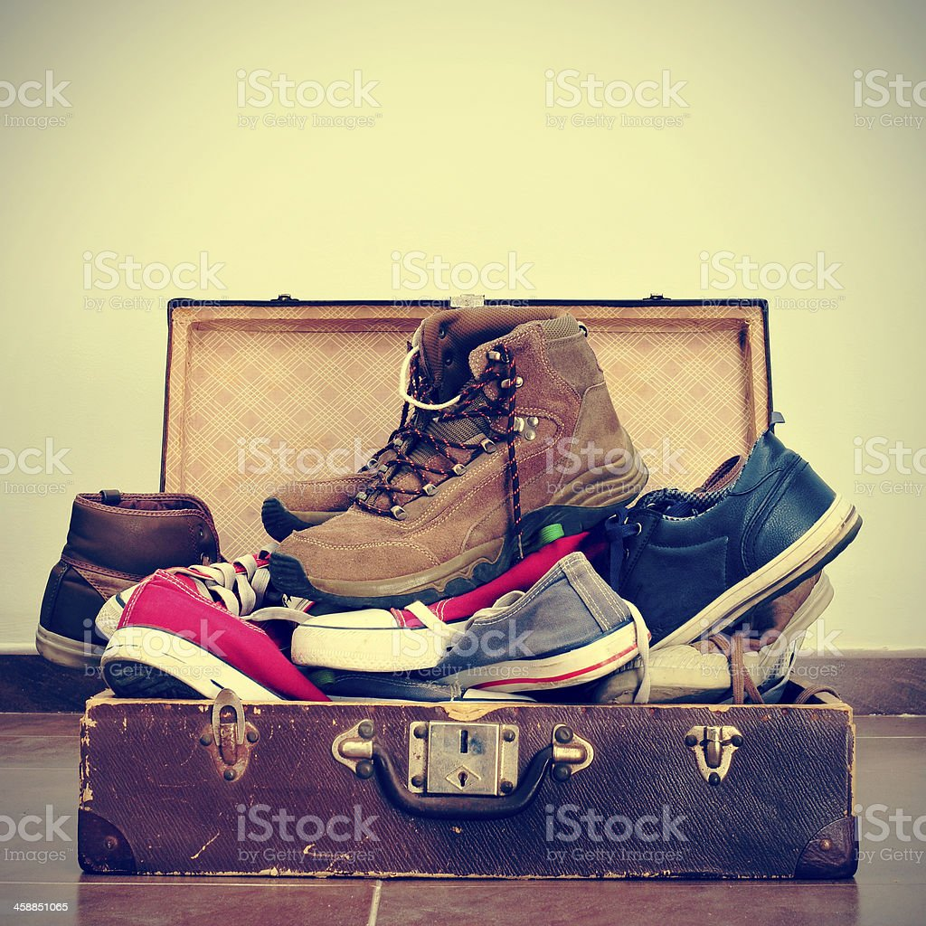 shoes in an old suitcase royalty-free stock photo
