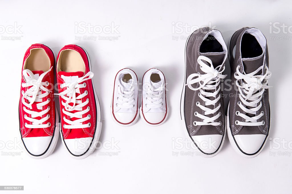 shoes in big small medium size in family concept stock photo