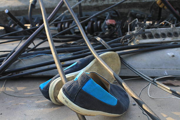 Shoes lay down near Power light pole crash across road Shoes  knocked down stock pictures, royalty-free photos & images