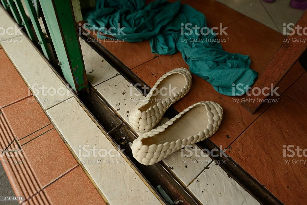 Shoes Left at the Door in Bangkok Thailand stock photo