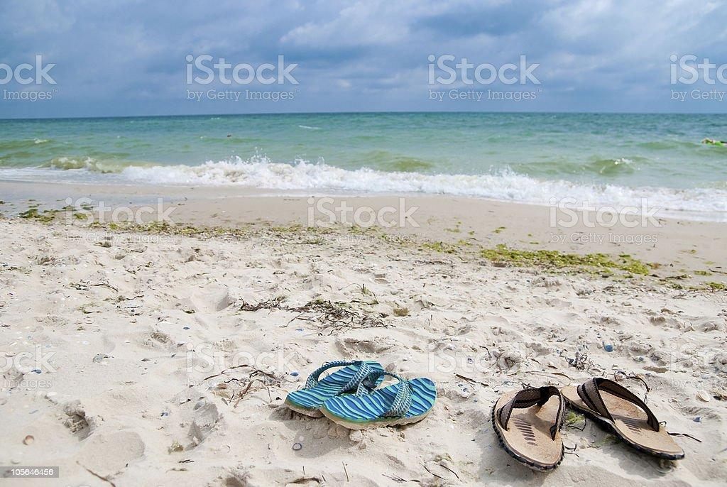 Shoes near sea stock photo