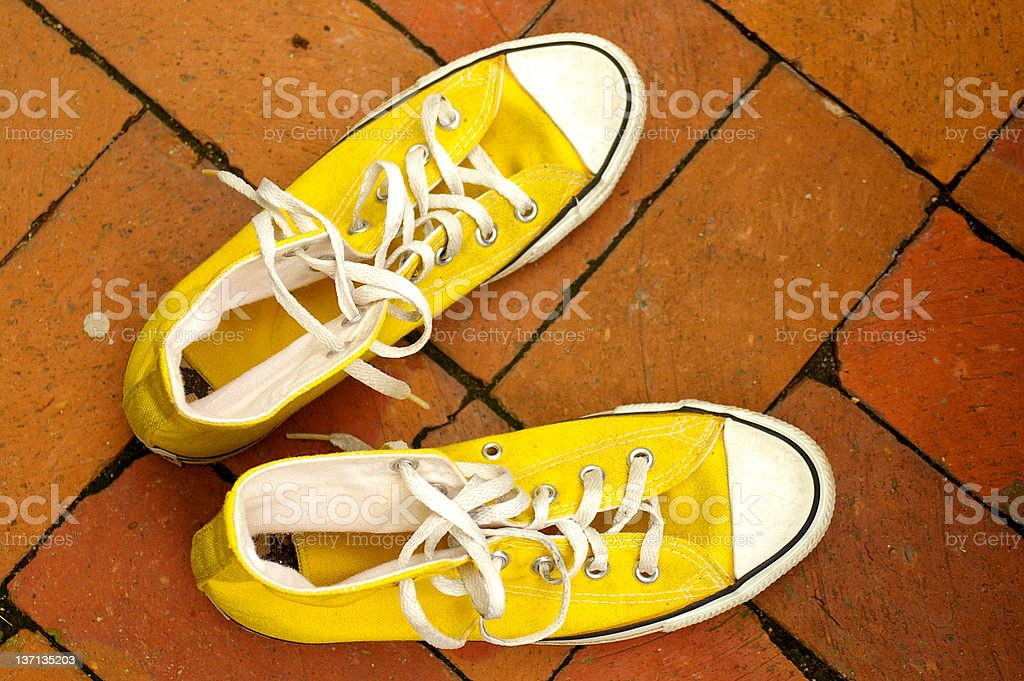 Shoes on bricks stock photo