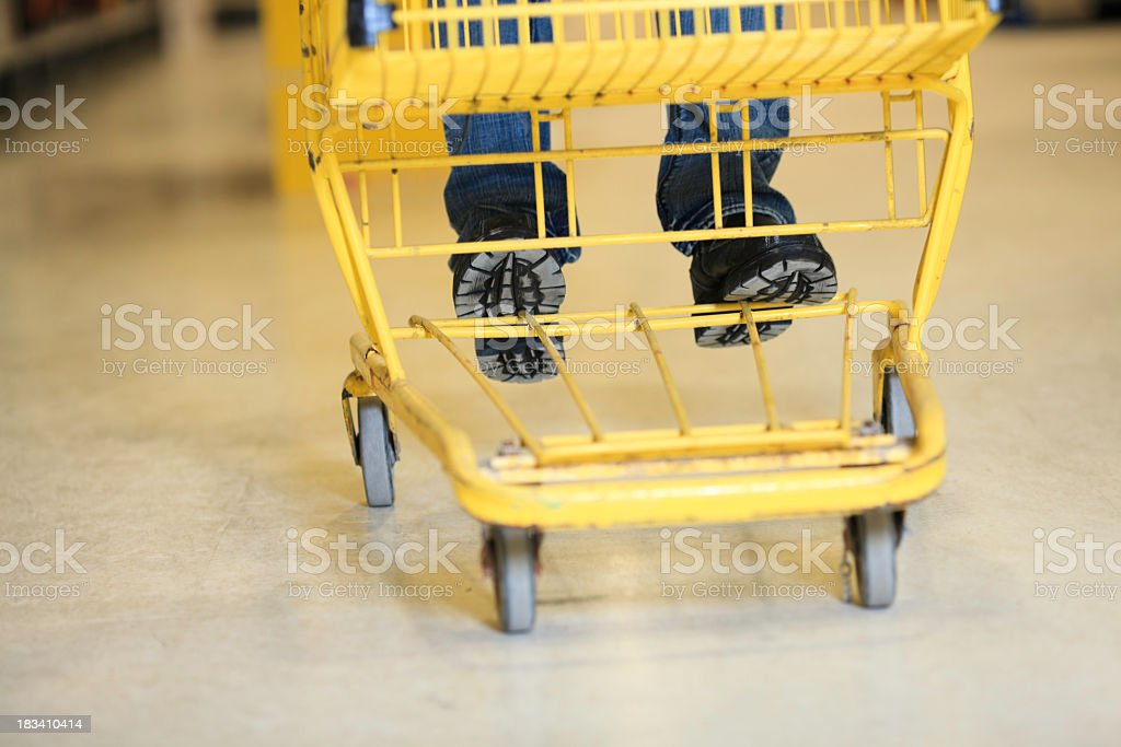 Shoes on Grocery Shopping Cart royalty-free stock photo
