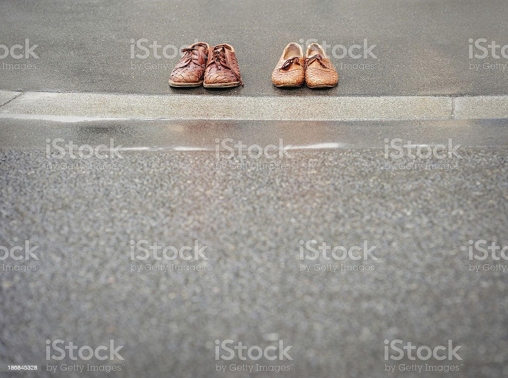 Shoes on sidewalk royalty-free stock photo