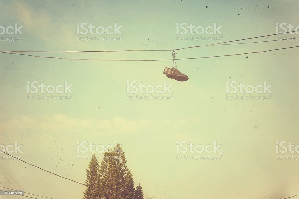Shoes on the wire stock photo