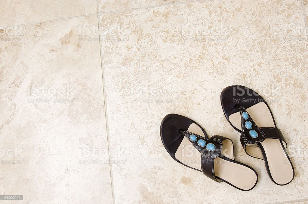 Shoes on Tile Floor royalty-free stock photo