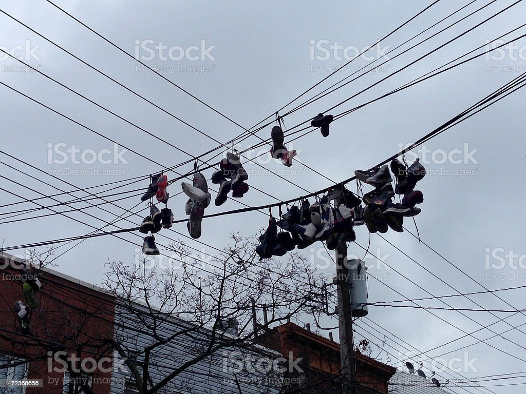 Shoes On Wires Above Street Stock Photo & More Pictures of 2015 | iStock