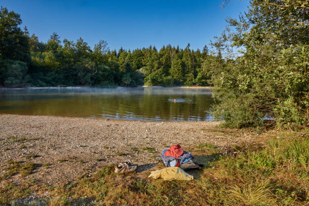 shoes, shirt, pants and towel at the beach - lakeshore stock photos and pictures