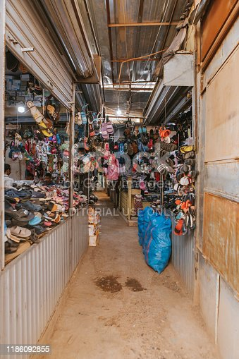 Rissani, Morocco - September 18th, 2019: Shoes shop stall inside Rissani bazaar market, in the city center of Rissani, Morocco.