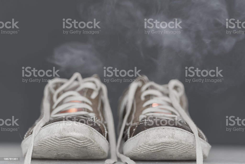 Shoes with smoke stock photo